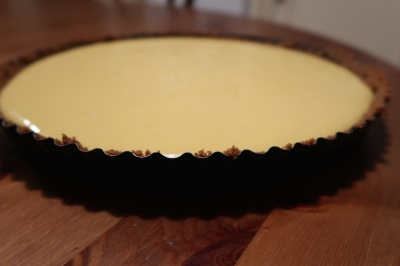 Pour mixture into tart case.